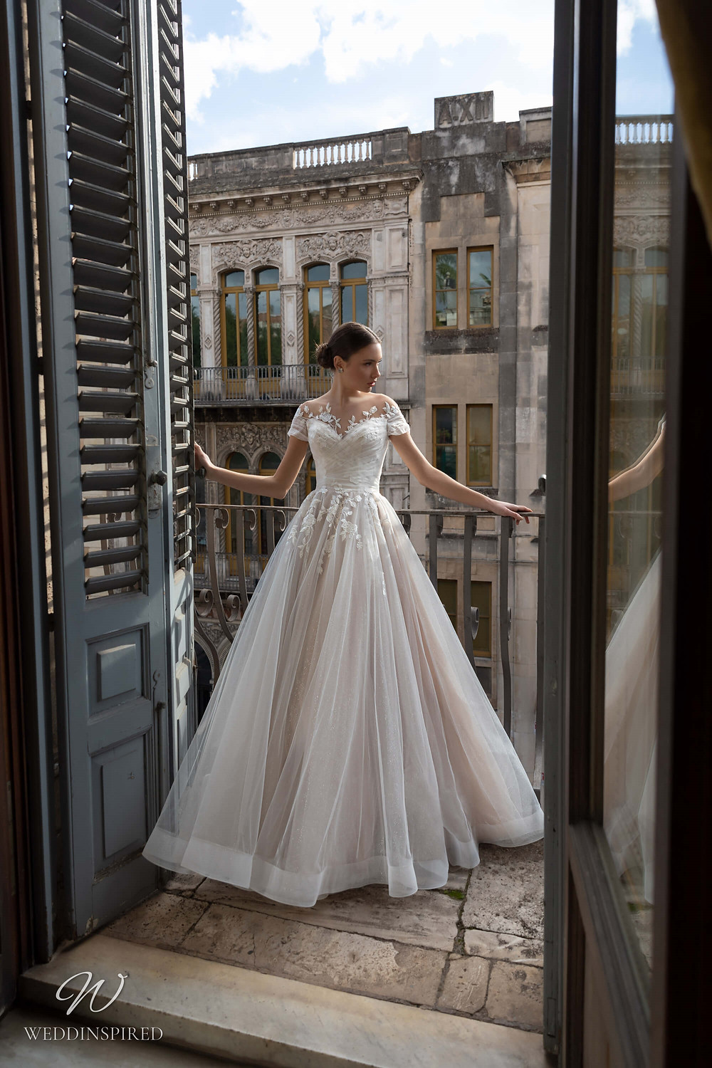 A Naviblue tulle ball gown wedding dress with cap sleeves