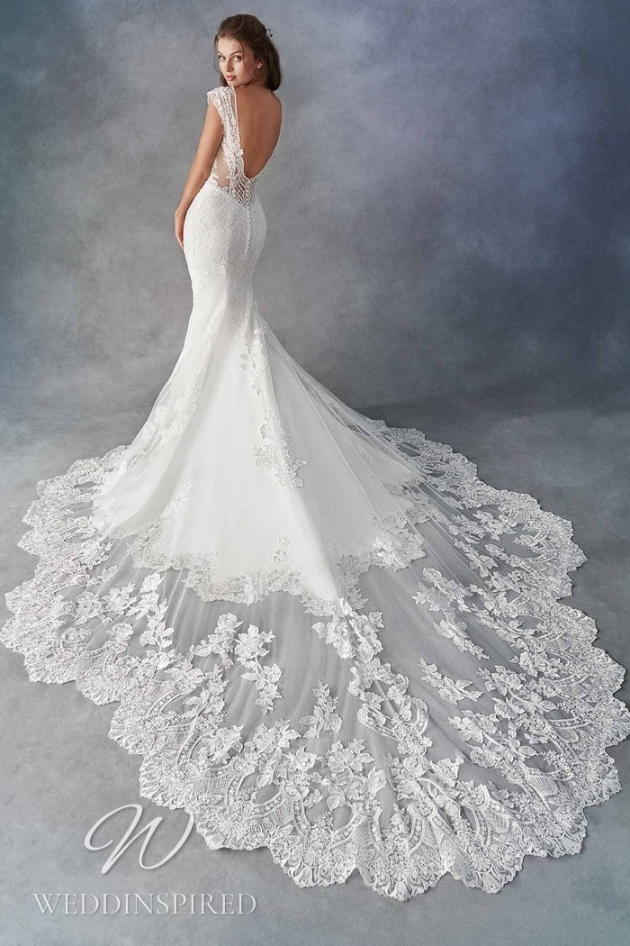 A Kenneth Winston 2021 lace mermaid wedding dress with a low back and a train