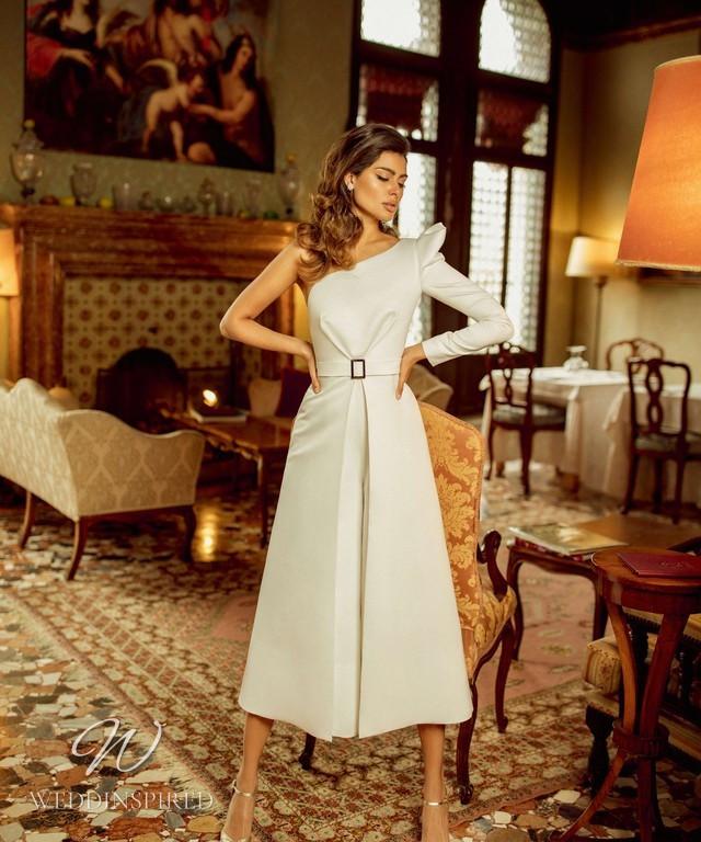 A Rara Avis 2021 one shoulder tea length wedding dress with long sleeves