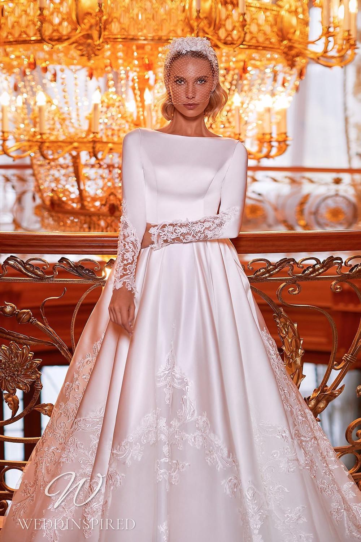 A Pollardi 2021 modest satin and lace princess wedding dress with long sleeves