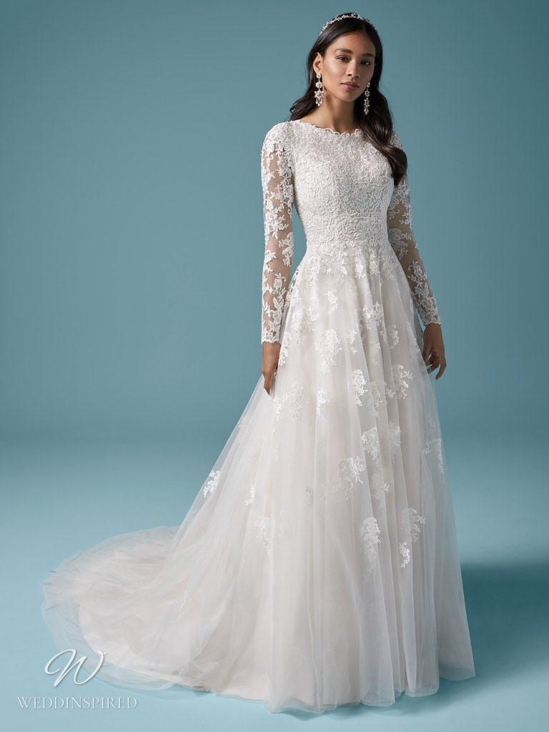 A Maggie Sottero 2021 modest lace and tulle A-line wedding dress with long sleeves