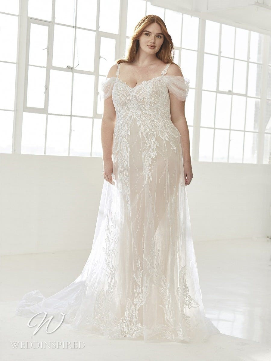 An Ashley Graham x Pronovias 2021 plus size off the shoulder sparkly mermaid wedding dress