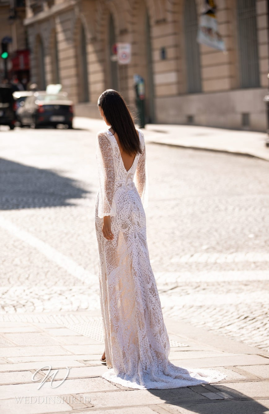 A Milla Nova sheath style lace wedding dress with long sleeves and a low back