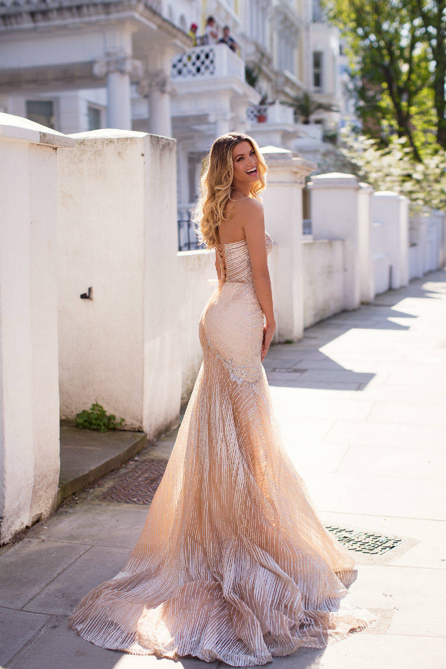 A shimmery pink mermaid wedding dress, with corset top and stripe pattern