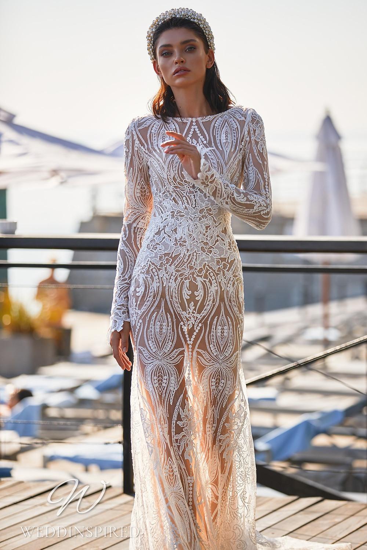 An Ida Torez 2021 lace mermaid wedding dress with long sleeves