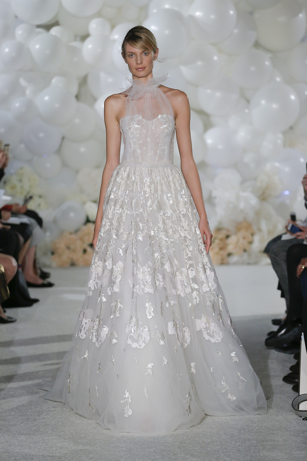 A Mira Zwillinger halterneck tulle and mesh A-line wedding dress