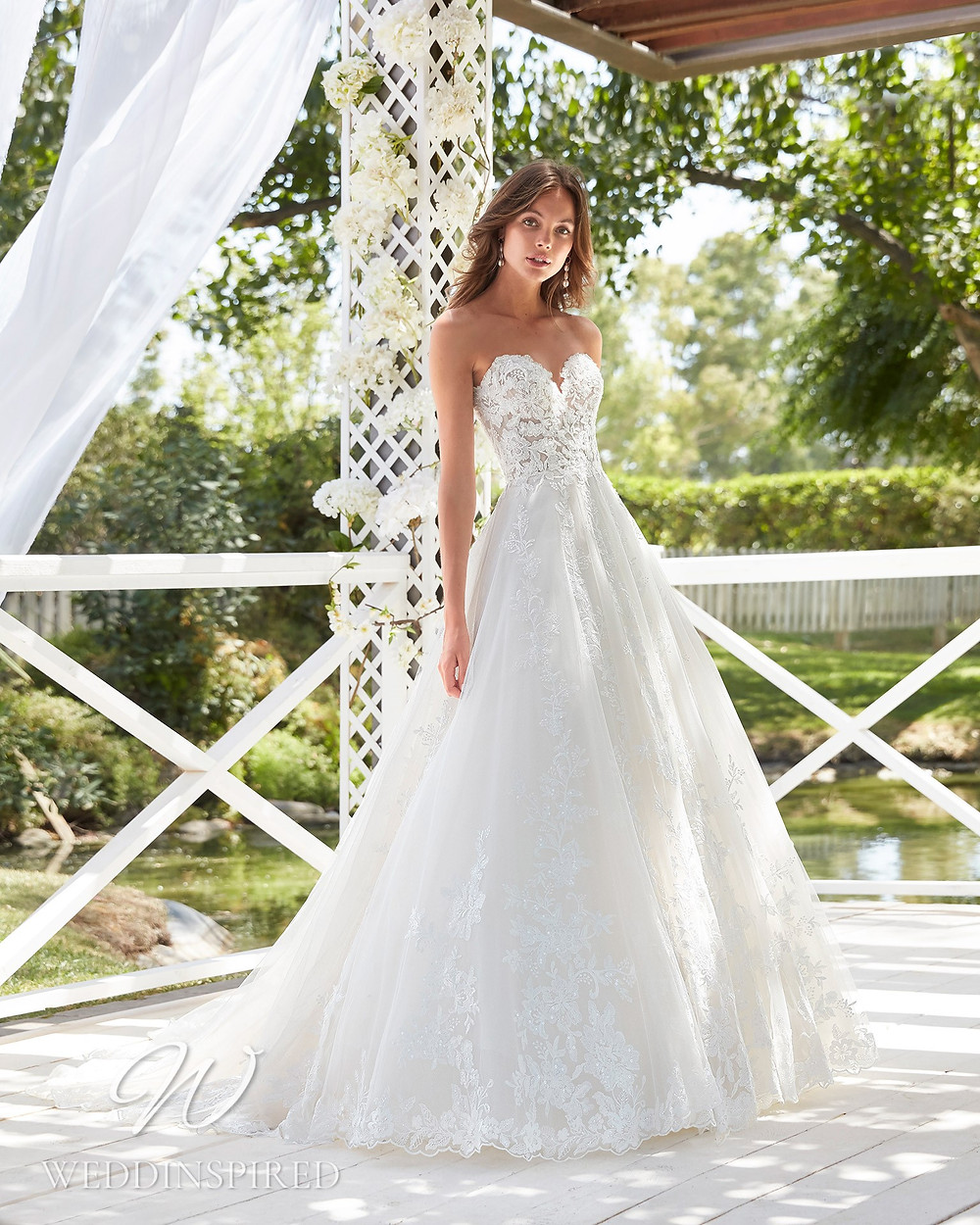 An Aire Barcelona 2021 strapless lace A-line wedding dress