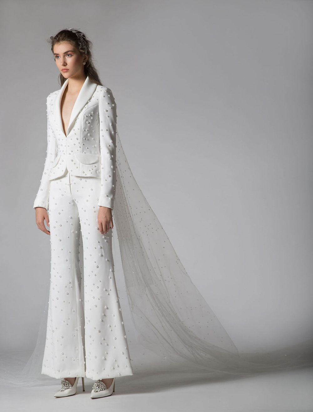 A Georges Hobeika wedding jumpsuit or pantsuit with long sleeves and pearls