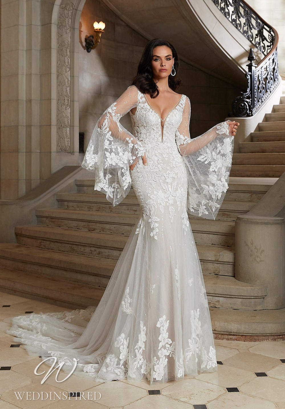A Madeline Gardner lace mermaid wedding dress with a v neckline and long sleeves