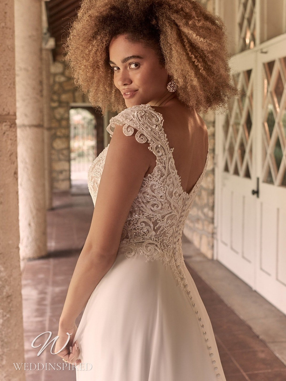 A Maggie Sottero Spring 2021 lace and crepe A-line wedding dress with a low back and buttons