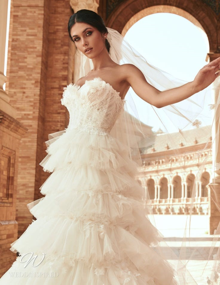 A Marchesa for Pronovias 2022 strapless ivory tulle A-line wedding dress with a ruffle skirt and a sweetheart neckline