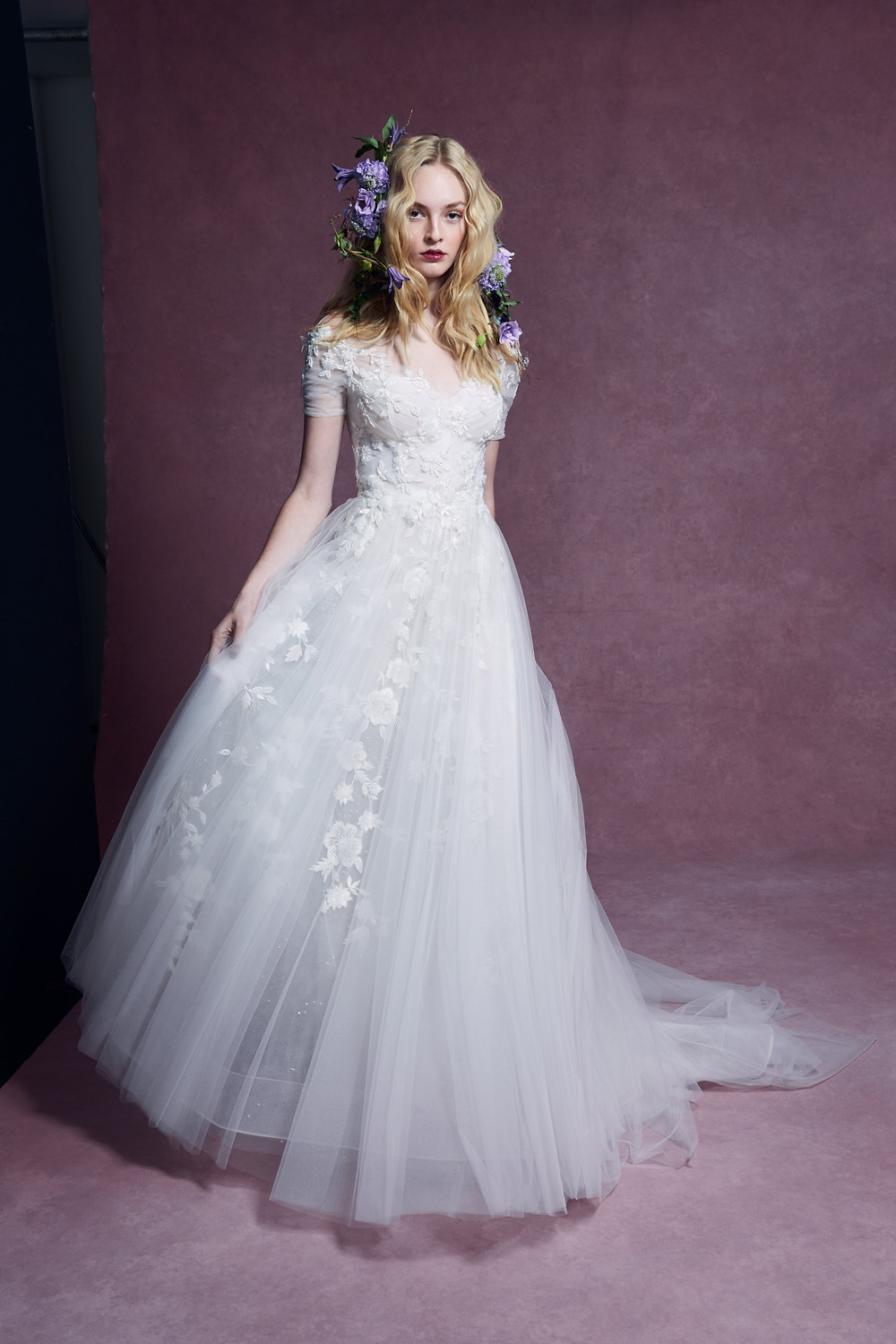 A Marchesa 2020 tulle ball gown wedding dress with cap sleeves, sweetheart neckline and flowers