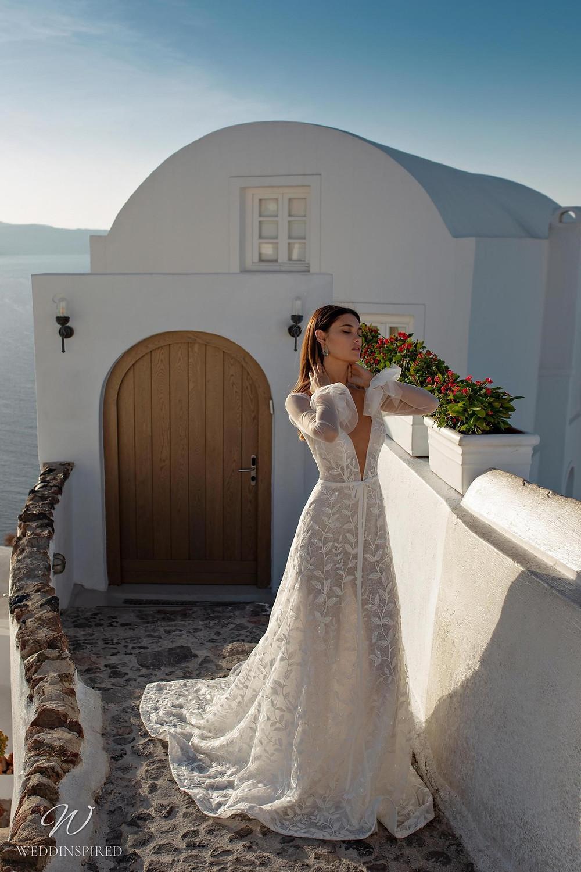 A Ricca Sposa gauzy tulle A-line wedding dress with a deep v neckline and long sleeves