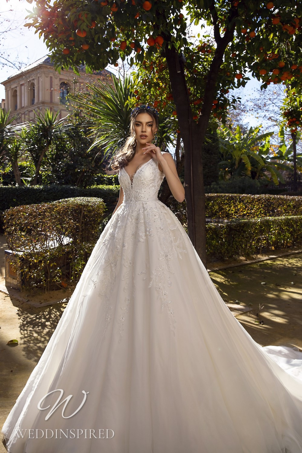 A Maks Mariano tulle and lace princess wedding dress