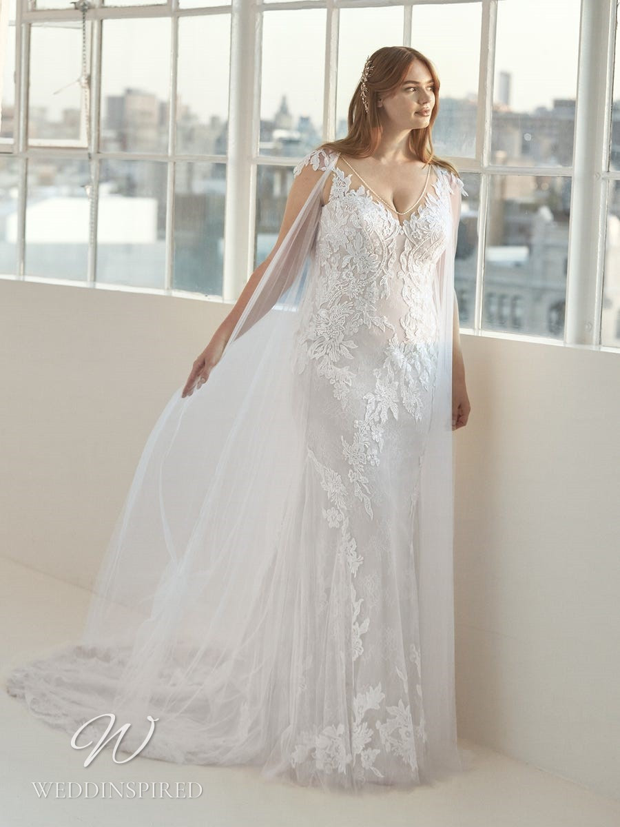 An Ashley Graham x Pronovias 2021 plus size lace mermaid wedding dress with a v neck and straps