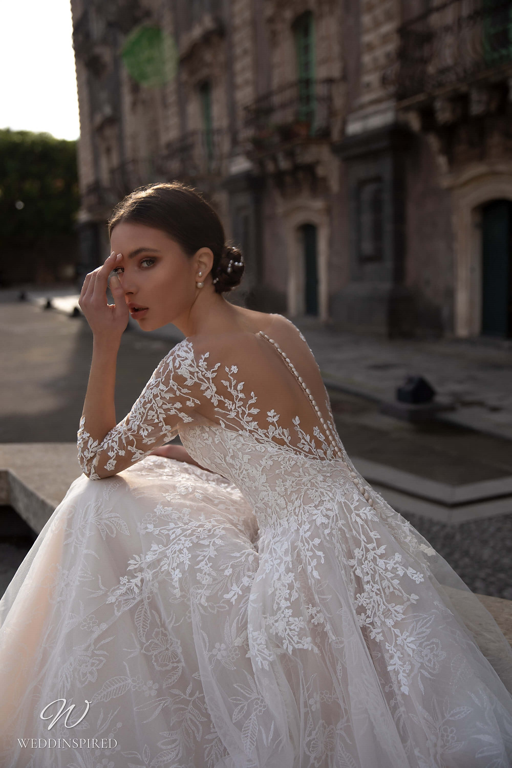A Naviblue lace ball gown wedding dress with long illusion sleeves