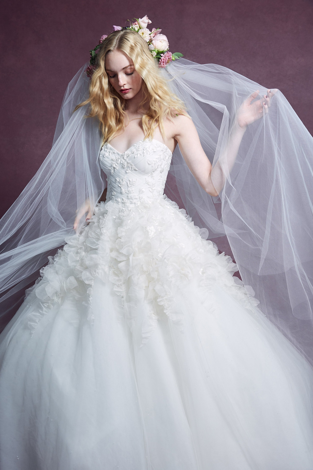 A Marchesa 2020 tulle ball gown wedding dress with sweetheart neckline corset top and a big skirt
