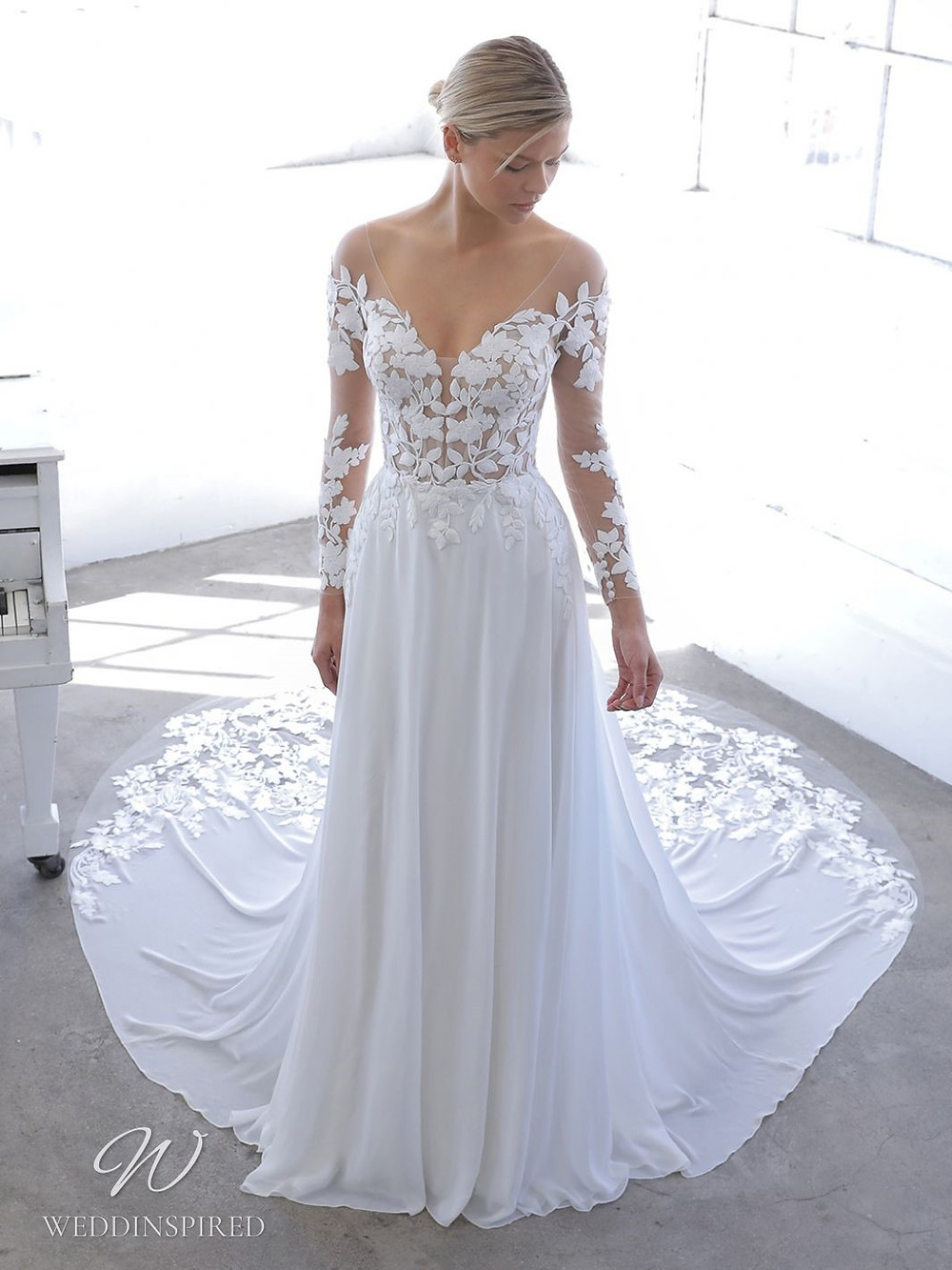 A Blue by Enzoani 2021 lace and crepe A-line wedding dress with long illusion sleeves