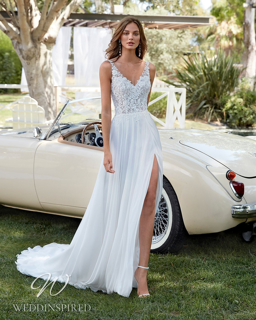 An Aire Barcelona 2021 flowy lace and chiffon A-line wedding dress with a slit