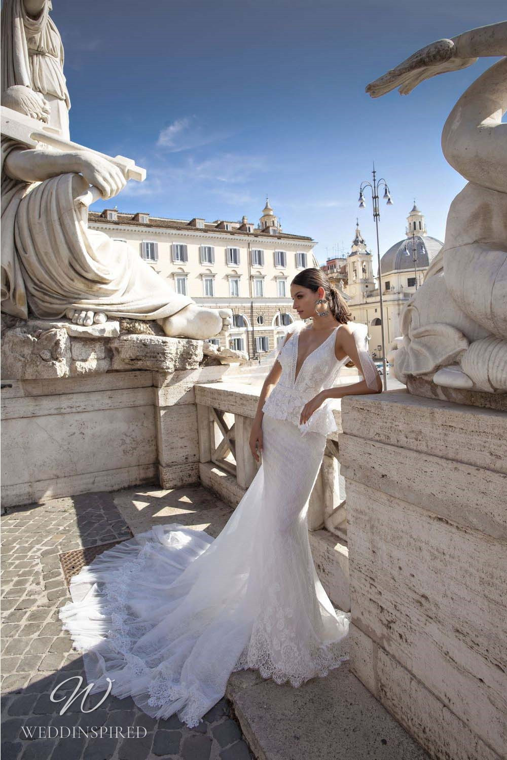 A Pinella Passaro lace mermaid wedding dress with a low v neckline and a train