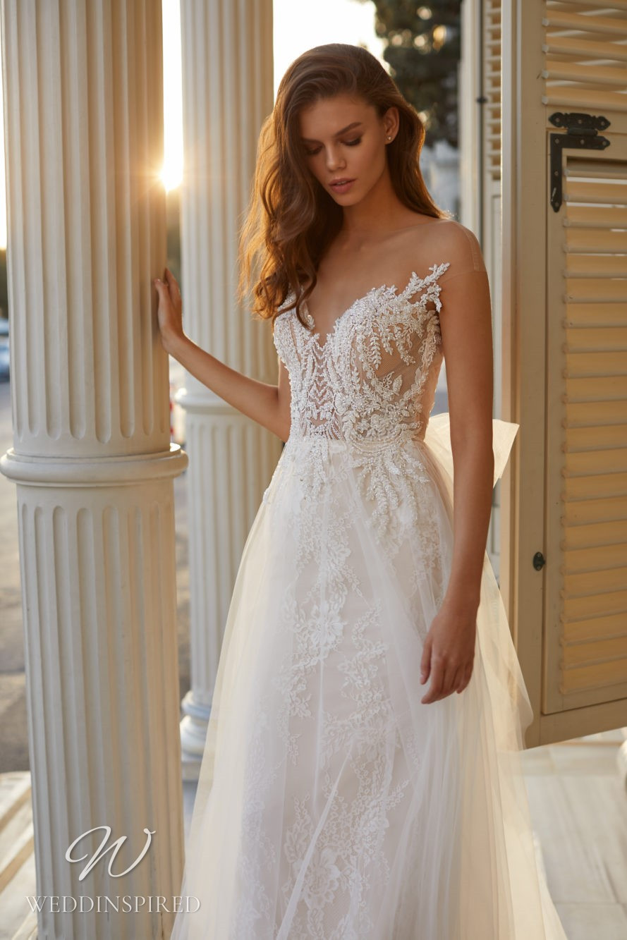 A Milla Nova 2021 lace and tulle A-line wedding dress with illusion cap sleeves
