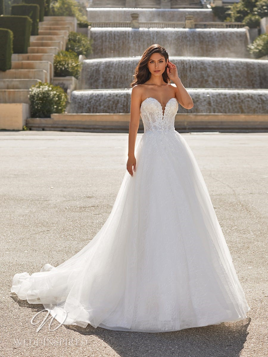 A Pronovias Privée 2021 strapless tulle and lace princess ball gown wedding dress