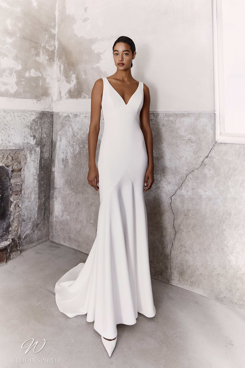 A Viktor & Rolf Fall/Winter 2021 simple mermaid wedding dress with straps and a v neckline