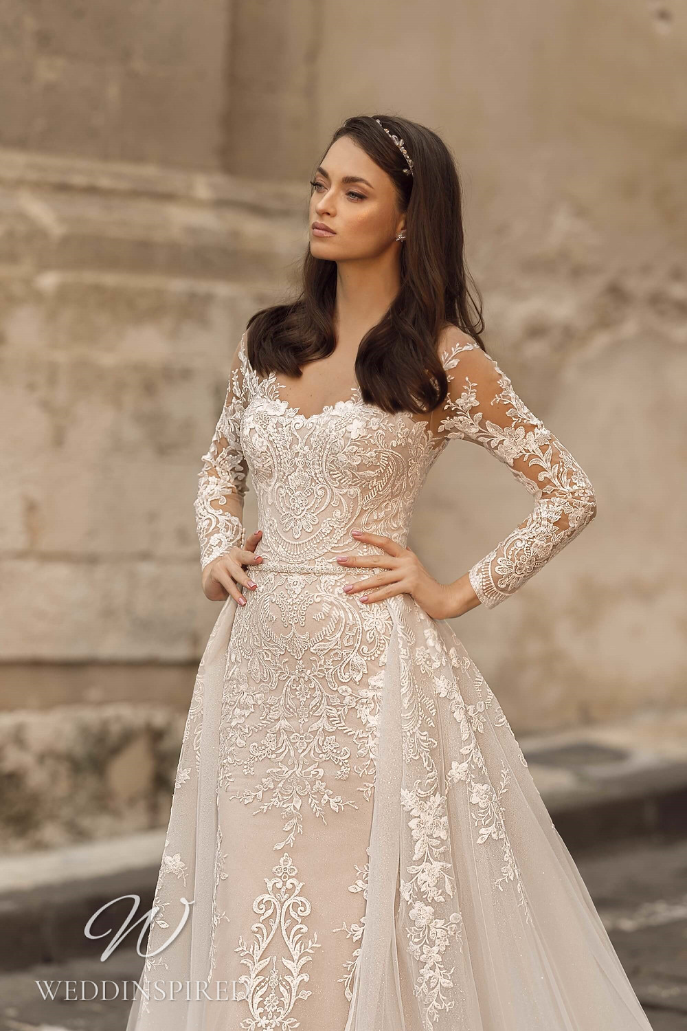 A Lussano 2021 blush lace and tulle mermaid wedding dress with a detachable skirt