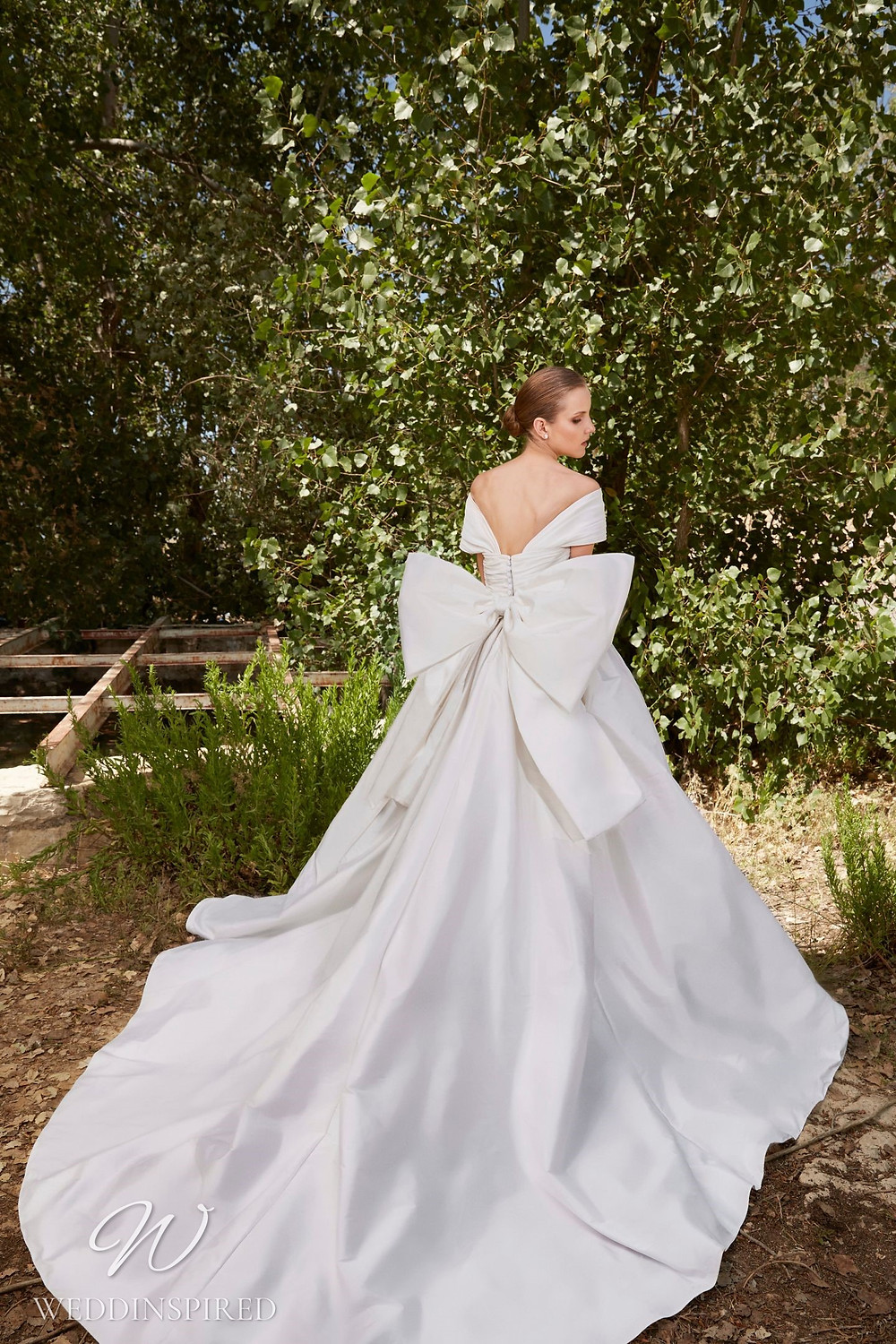 An Elie Saab Spring 2021 simple off the shoulder satin ball gown wedding dress with a big bow