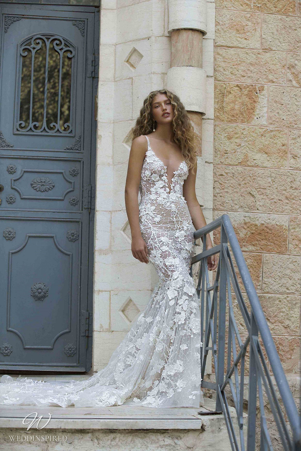 A Berta Colony 2021 lace mermaid wedding dress with straps and a train
