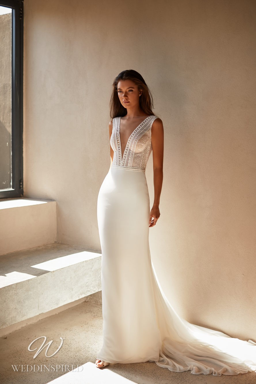 A Milla by Lorenzo Rossi 2021/2022 simple knitted and crepe mermaid wedding dress with straps and a v neck