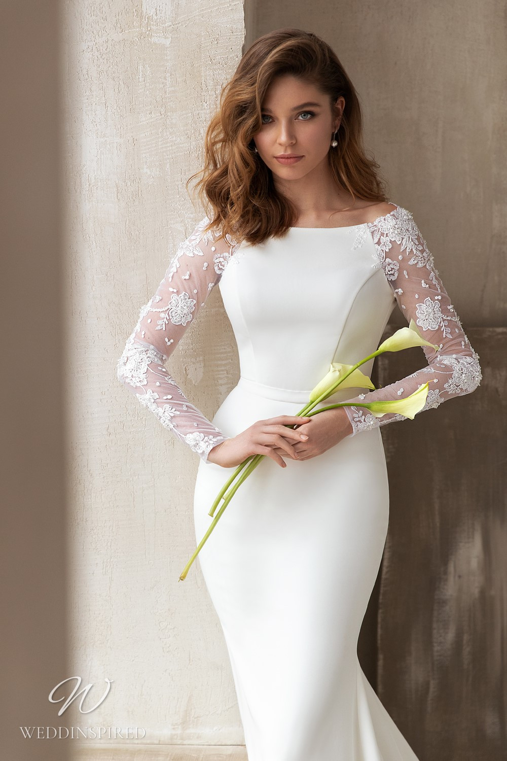 An Eva Lendel 2021 crepe and lace mermaid wedding dress with long illusion sleeves