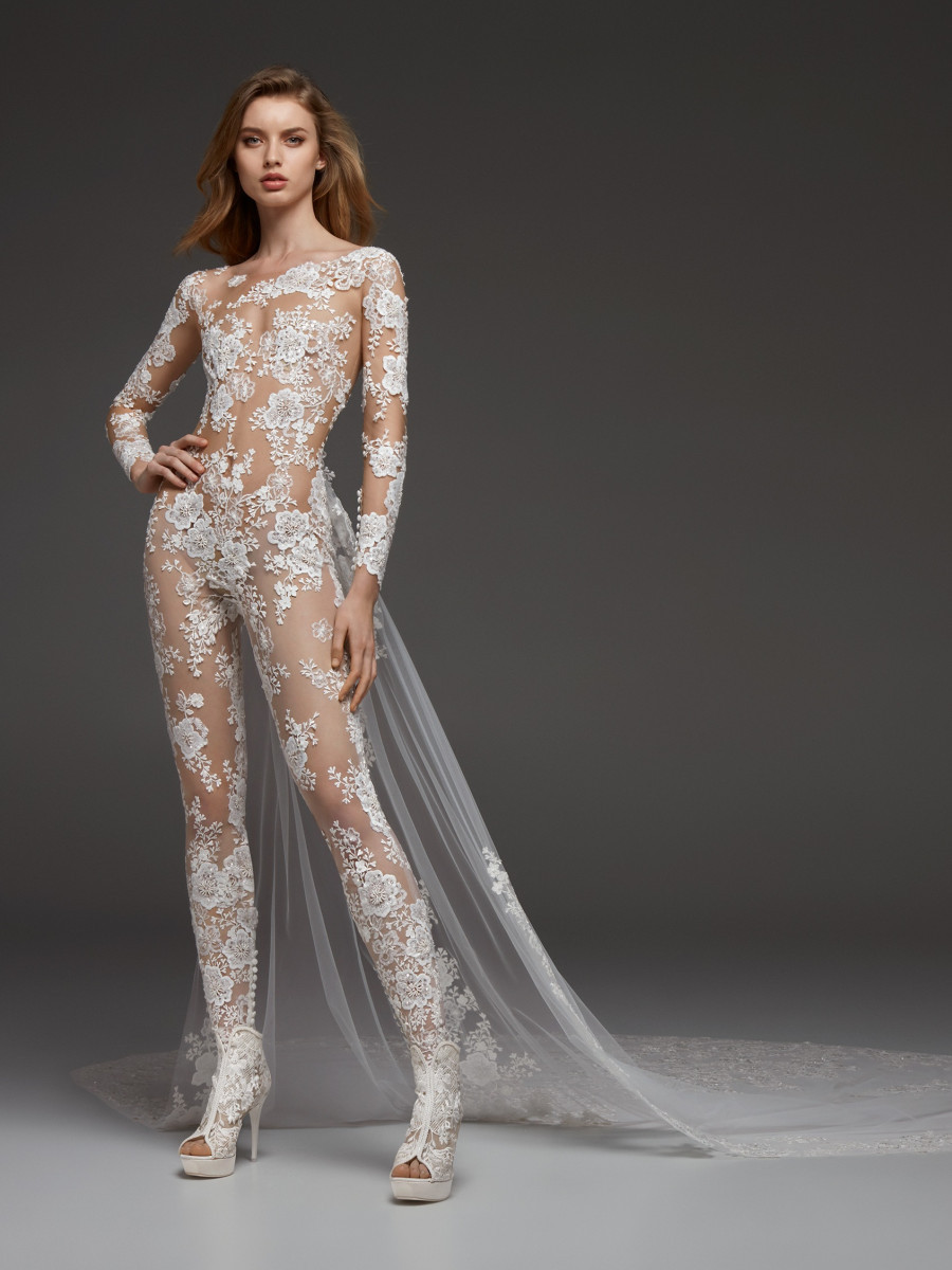 An Atelier Pronovias lace wedding jumpsuit or pantsuit with long sleeves