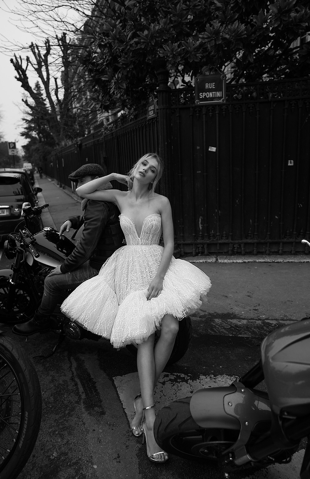 An Inbal Dror short beaded tulle wedding dress with a ruffle skirt