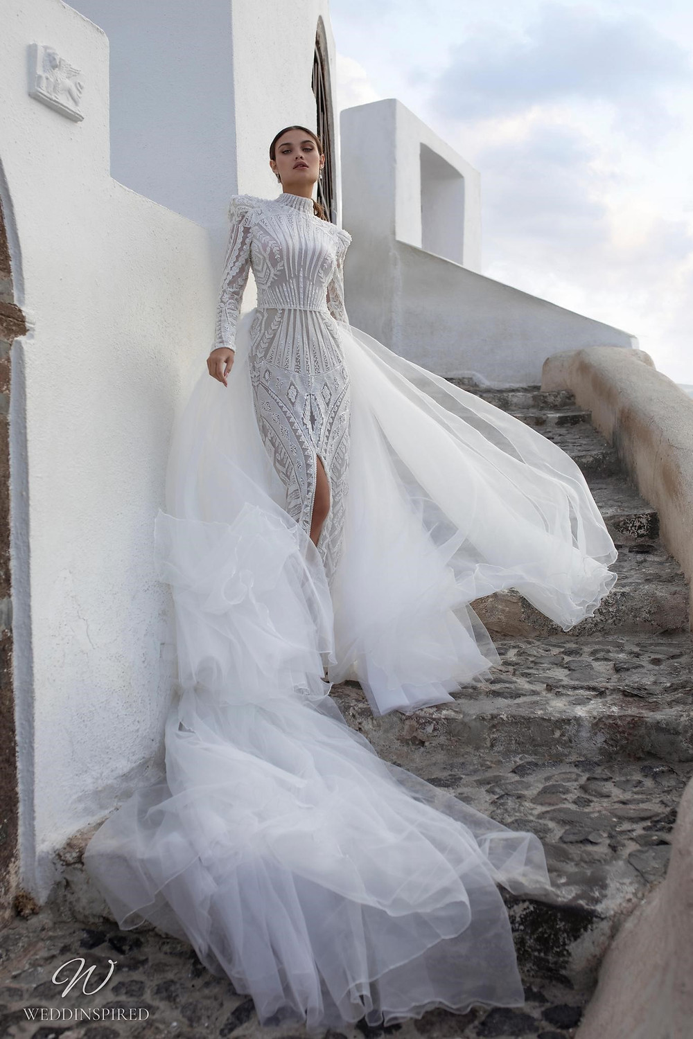 A Ricca Sposa lace high neck column wedding dress with a tulle detachable skirt, long sleeves and a high slit