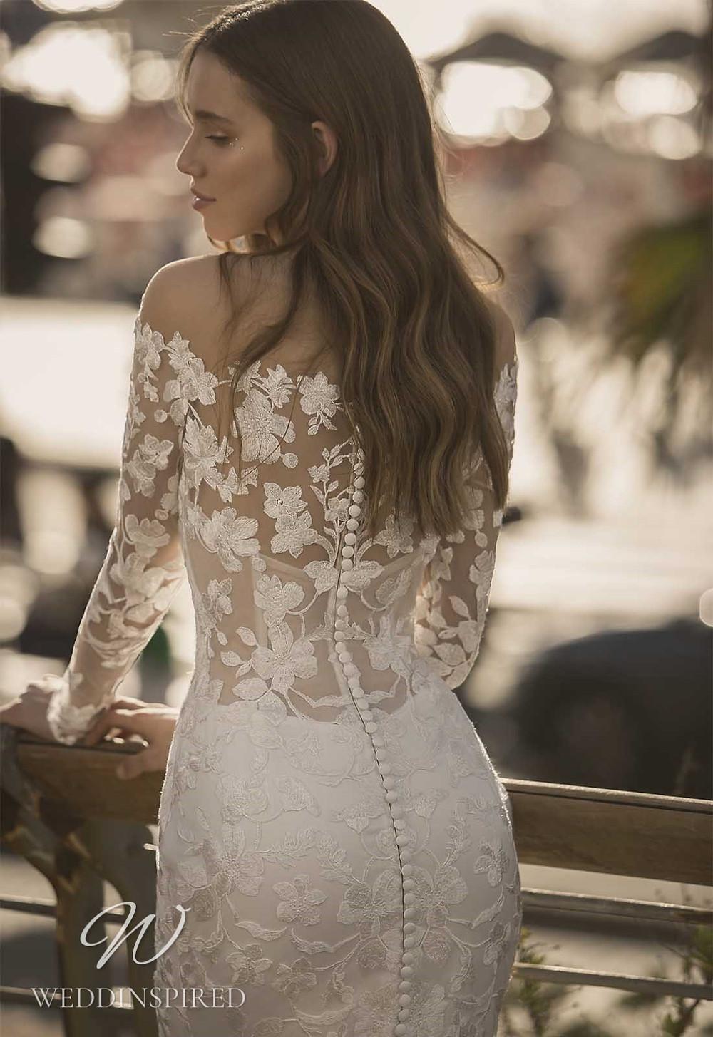 A Pnina Tornai 2021 off the shoulder lace mermaid wedding dress