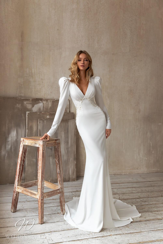 An Eva Lendel 2021 simple crepe mermaid wedding dress with long puff sleeves