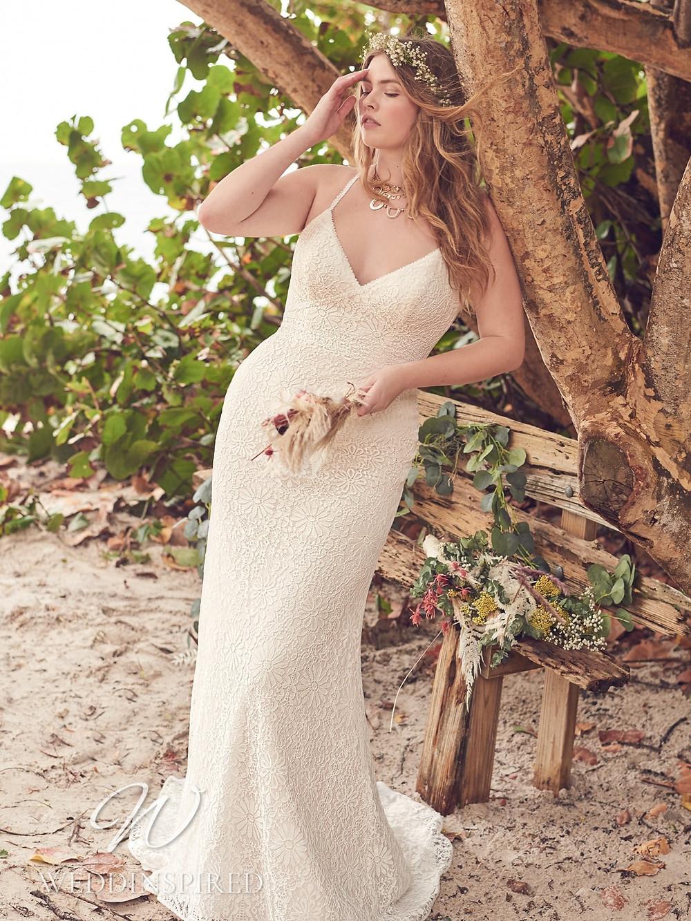 A Rebecca Ingram 2021 plus size ivory lace mermaid wedding dress with a v neck