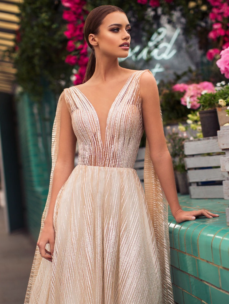 A blush A-line wedding dress, with stripe pattern and low v neckline
