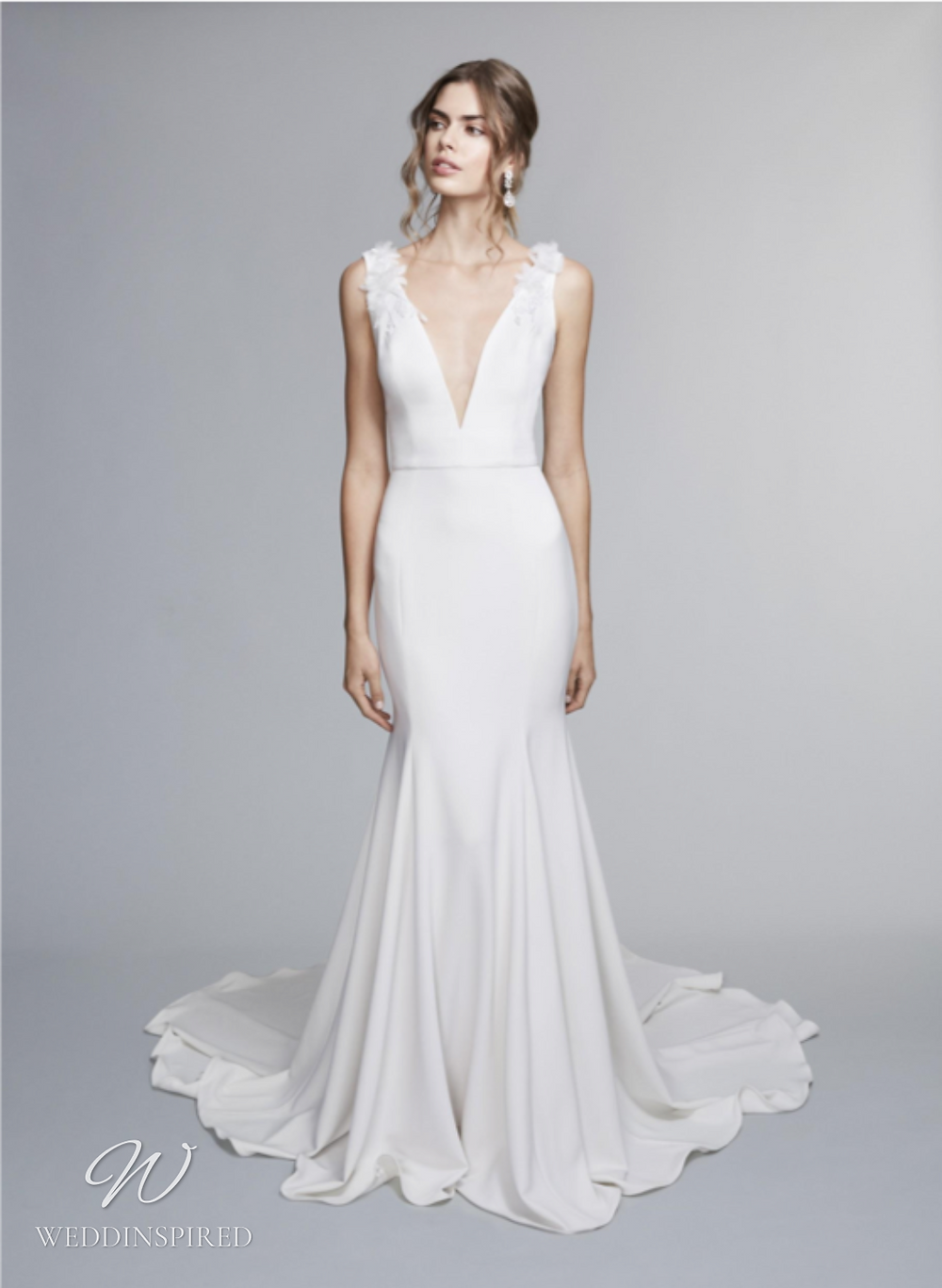 A Marchesa Notte Fall 2021 simple satin mermaid wedding dress with thick straps and a v neck
