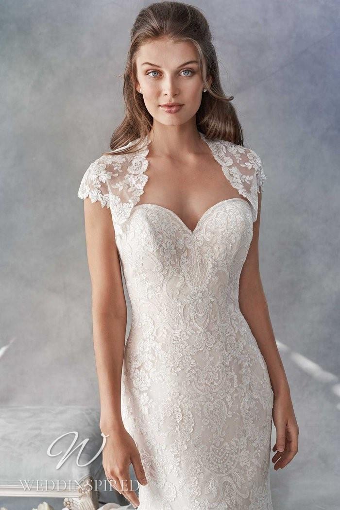 A Kenneth Winston 2021 lace mermaid wedding dress with a jacket