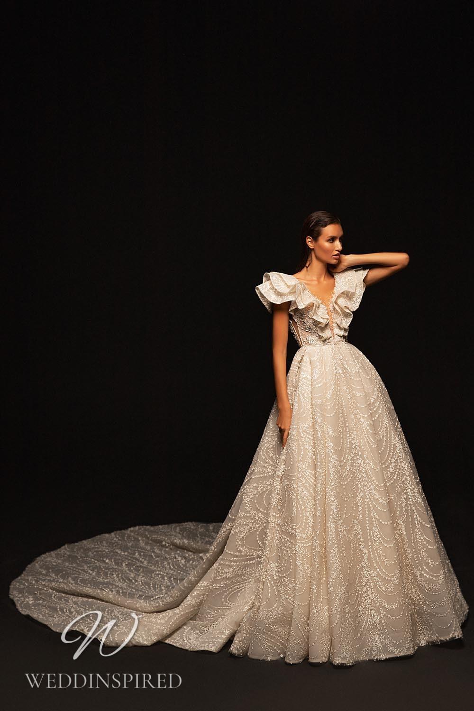 A WONÁ Concept 2021 champagne princess wedding dress with ruffles