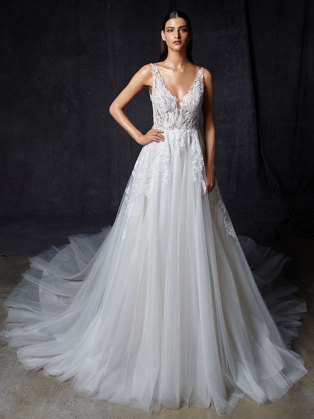 An Enzoani v neck, lace and tulle A-line wedding dress with straps