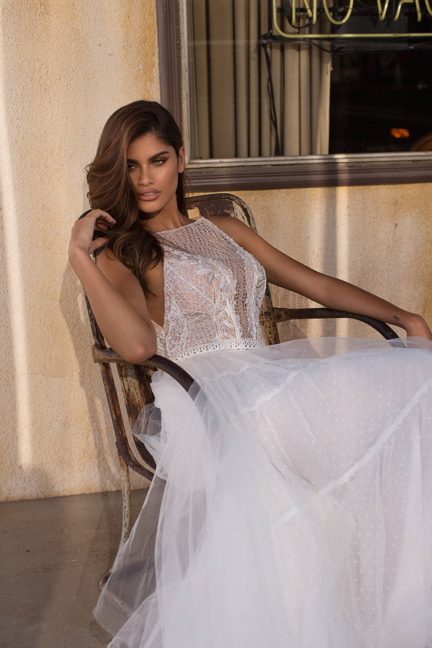 A Milla Nova halterneck mesh and tulle A-line wedding dress