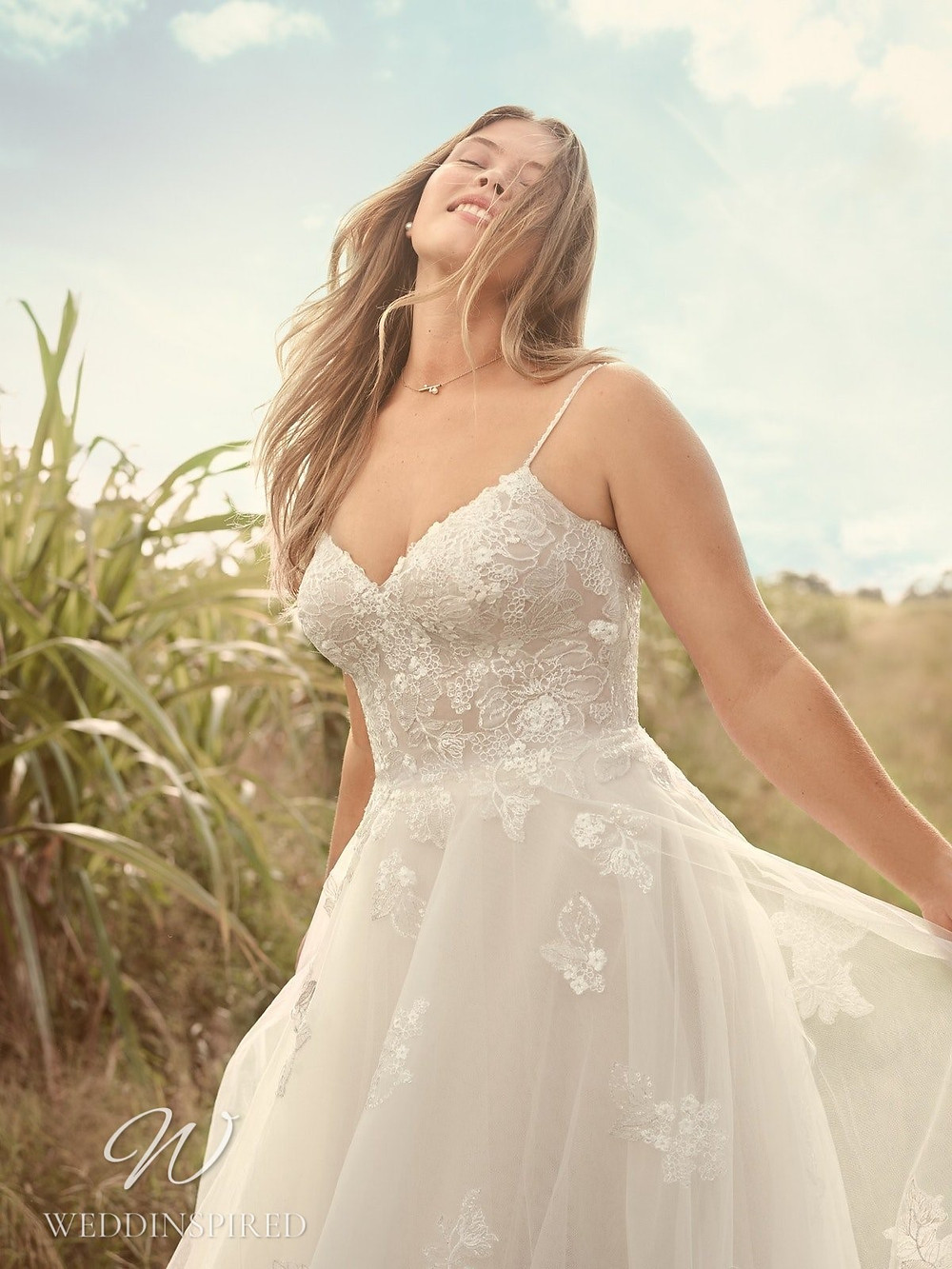 A Rebecca Ingram Spring 2021 lace and mesh A-line wedding dress with straps and a v neck