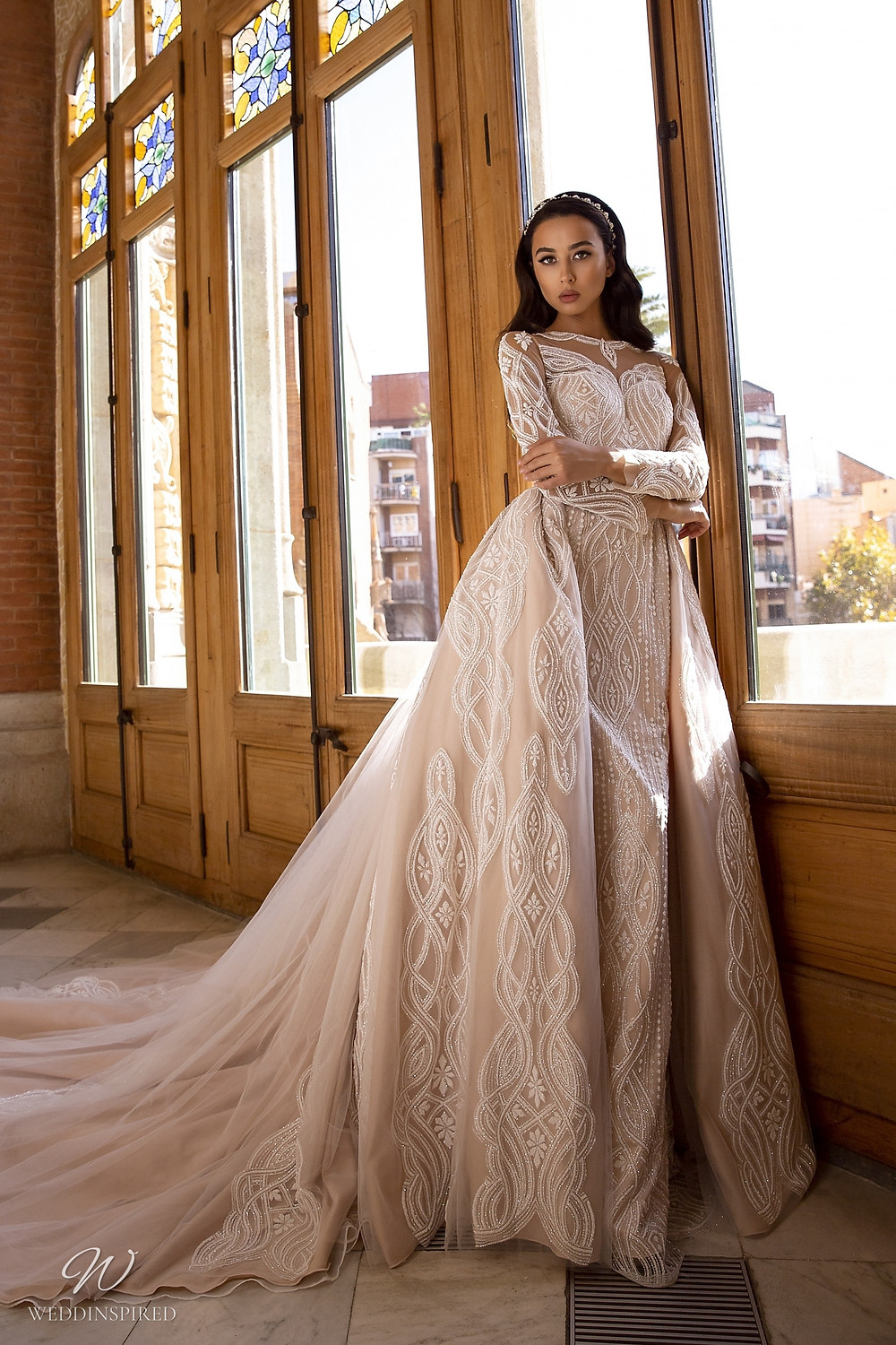 A Maks Mariano tan sparkle princess ball gown wedding dress with a detachable skirt and long sleeves