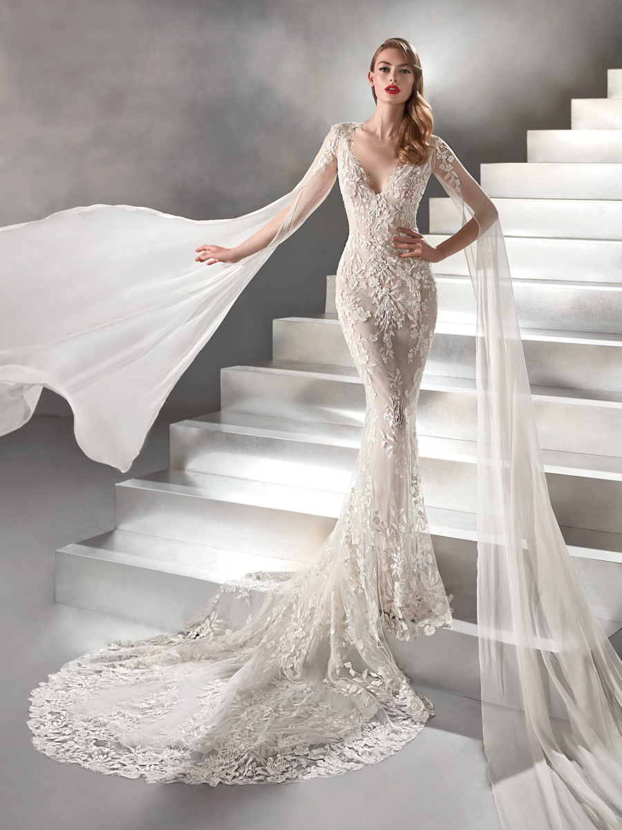 A Pronovias lace mermaid fit and flare wedding dress with long sleeves