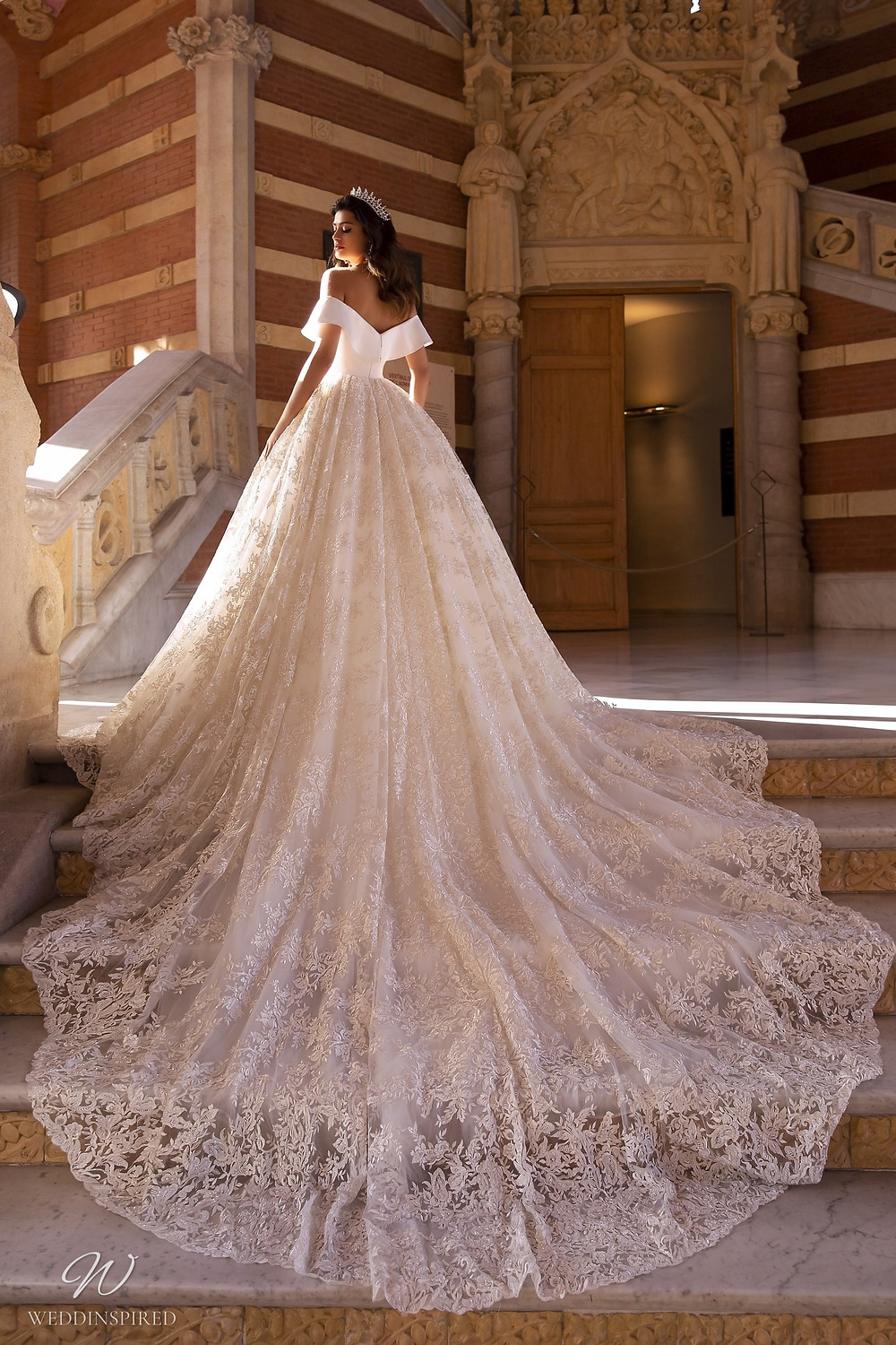A Maks Mariano lace off the shoulder princess ball gown wedding dress with a train