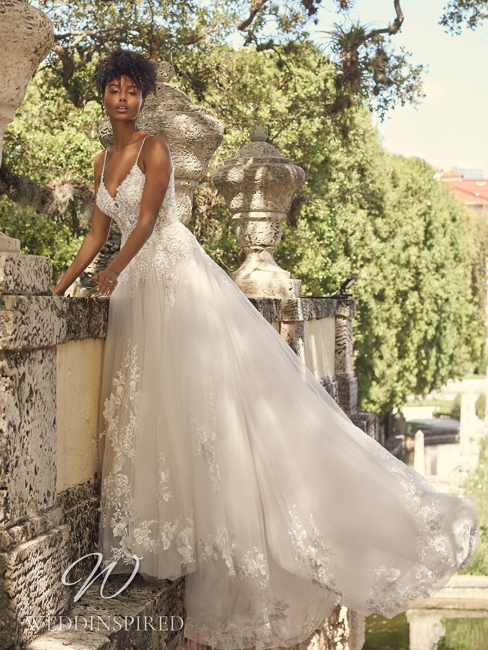 A Maggie Sottero 2021 lace and tulle A-line wedding dress