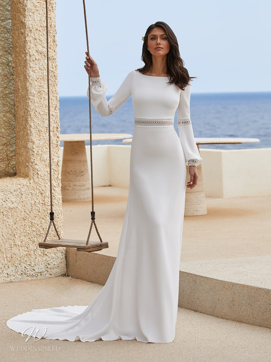 A Pronovias 2021 simple crepe column wedding dress with long sleeves and a high neckline
